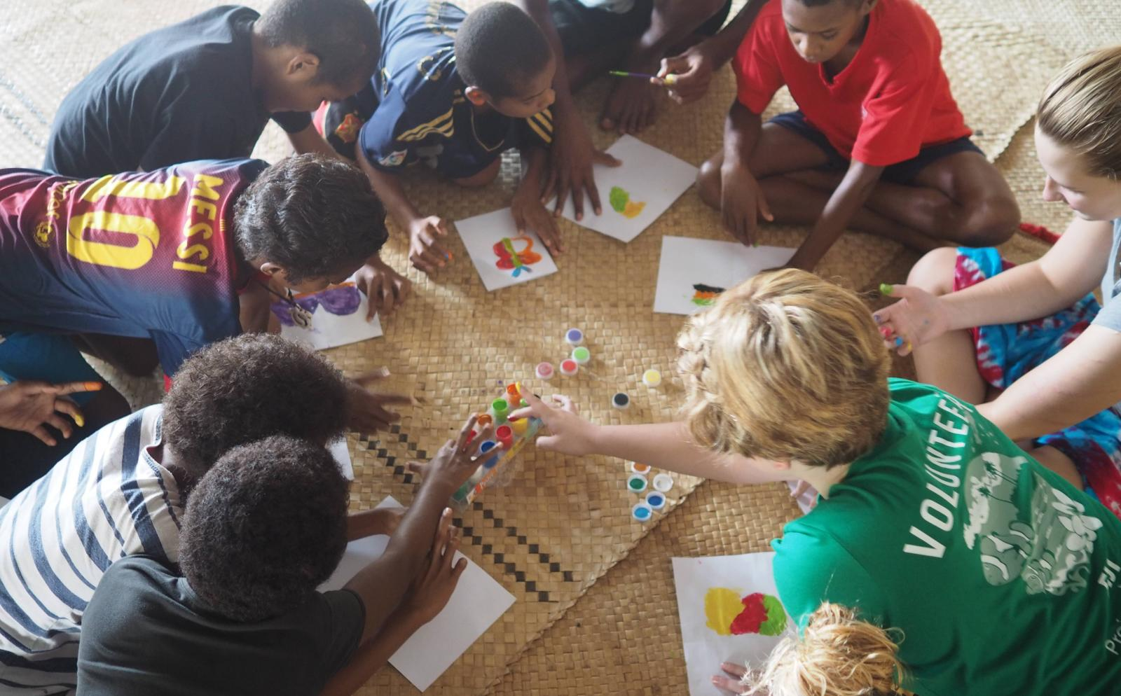 Projects Abroad volunteers play educational games with children from a nursery school rather than an orphanage abroad